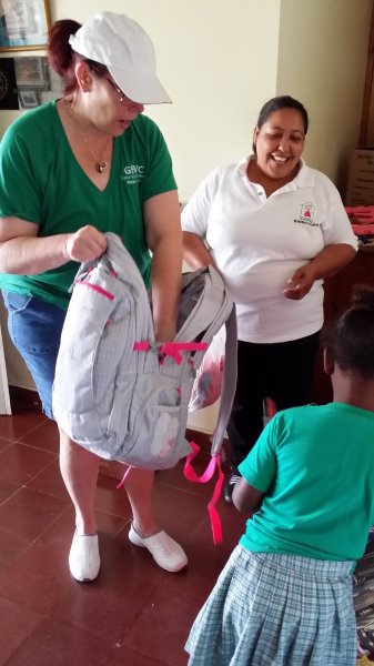 President Karin D'Amico distributing supplies in Santo Domingo