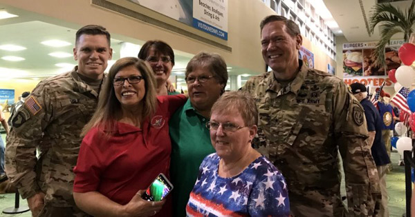 Club members with military members awaiting vets' arrival