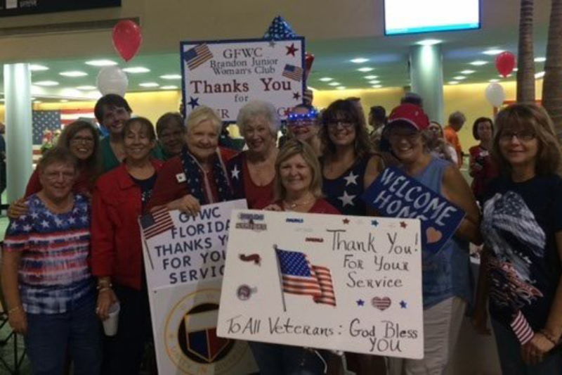 Club members and sister clubs at airport to greet vets
