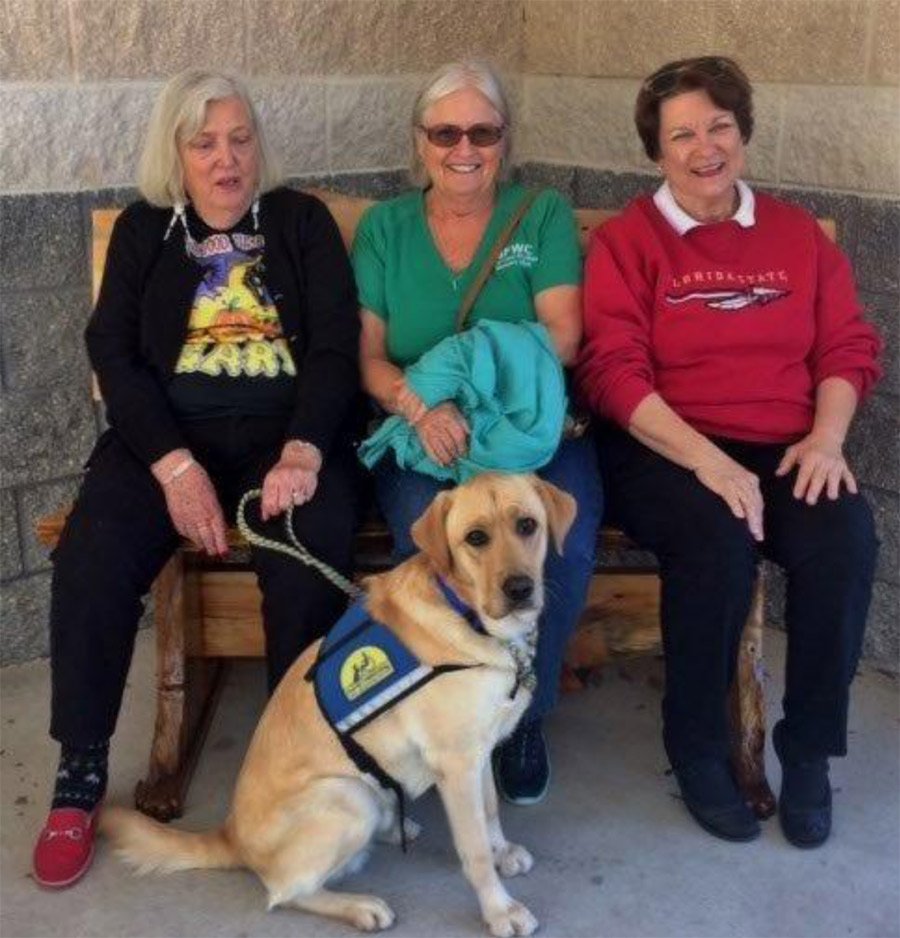 Photo:  (l-r) Members Nancy Fisher, Andrea Sands and Chair Edwina R. Kraemer with recent graduate puppy