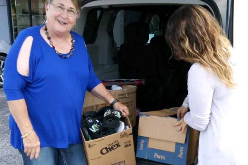 (L-R) Chair Madeline McCulloh with 'Soles' Collection Point Staffer