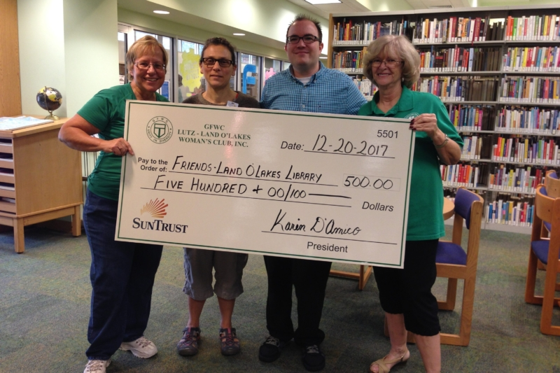 Club Presents Donation to Land O Lakes Library